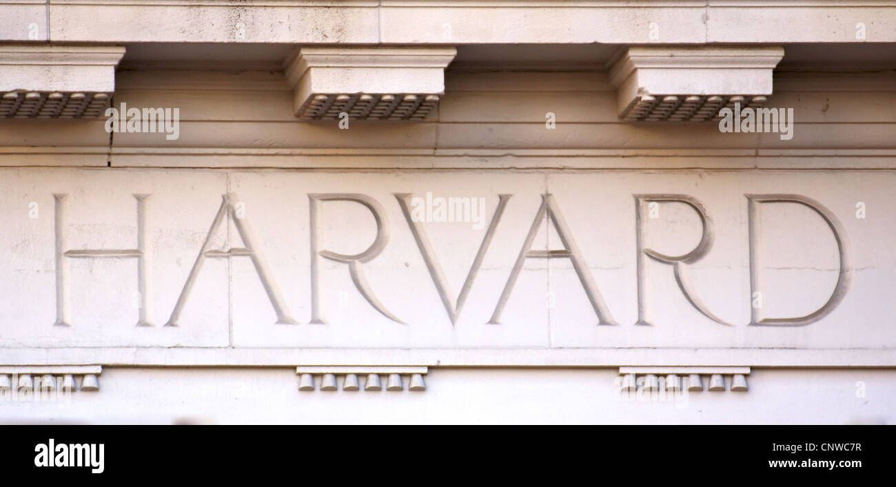 The Word 'Harvard' chiseled into the limestone of a university building in Cambridge, MA (taken on August - Stock Image