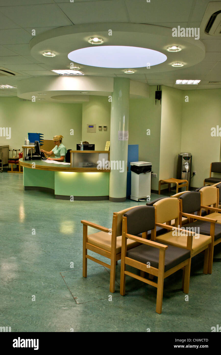 Modern hospital outpatients / fracture clinic waiting room / reception. - Stock Image