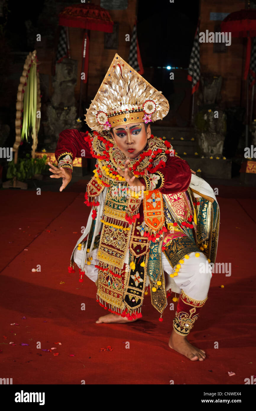 Balinese dancer performing the dance of the warrior in Padangtegal temple, Ubud, Bali, Indonesia - Stock Image