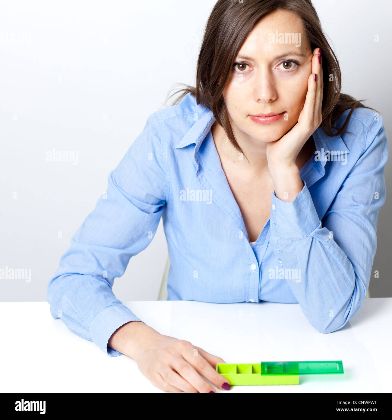 woman with daily dose of medication - Stock Image