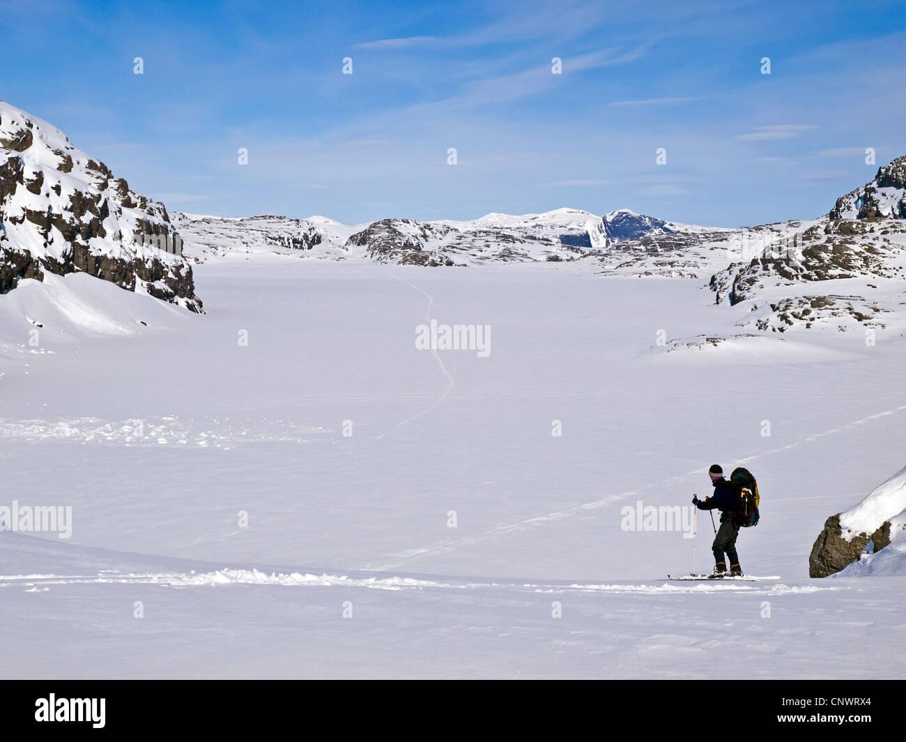 Male skier ski touring in Norway's Hardanger region - Stock Image