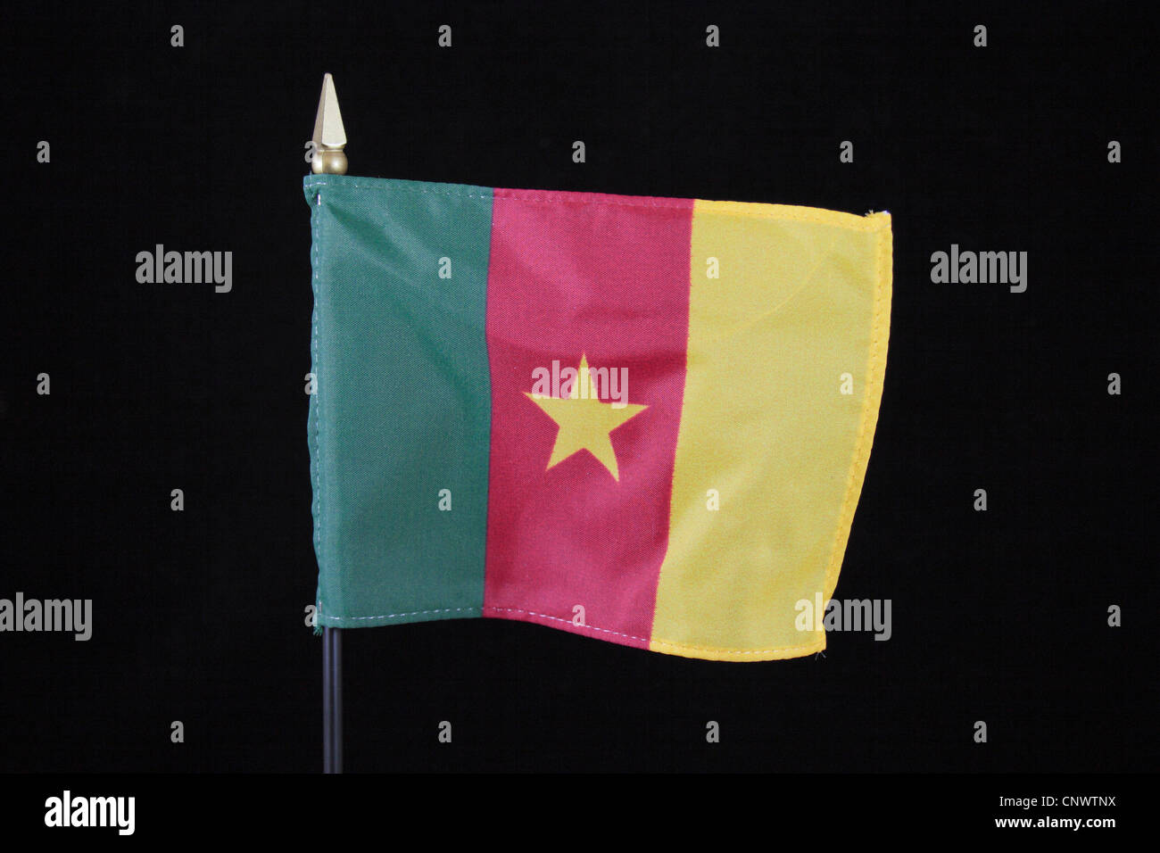 The national flag of the Republic of Cameroon on a black background. - Stock Image