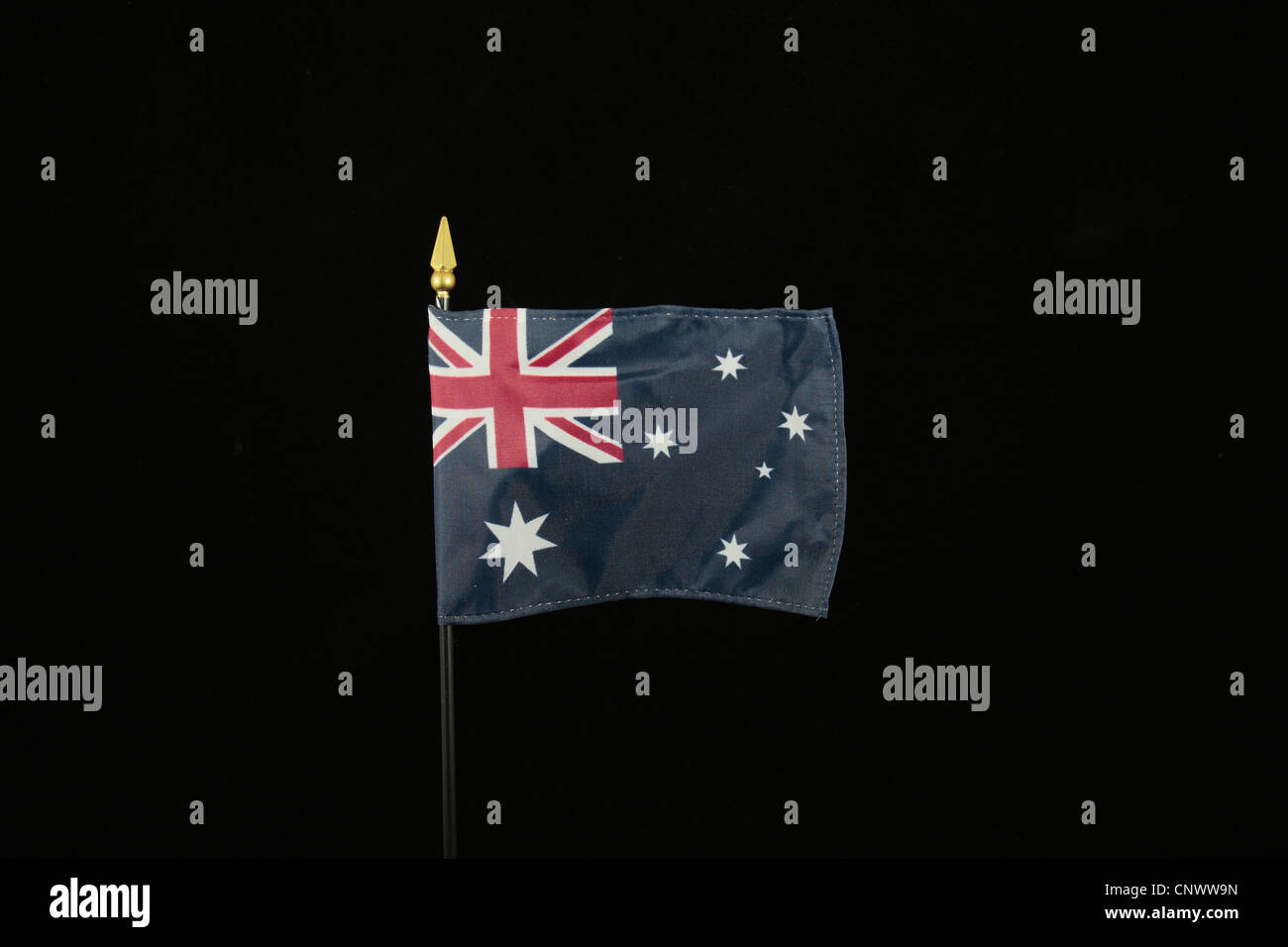 The national flag of Australia on a black background. - Stock Image
