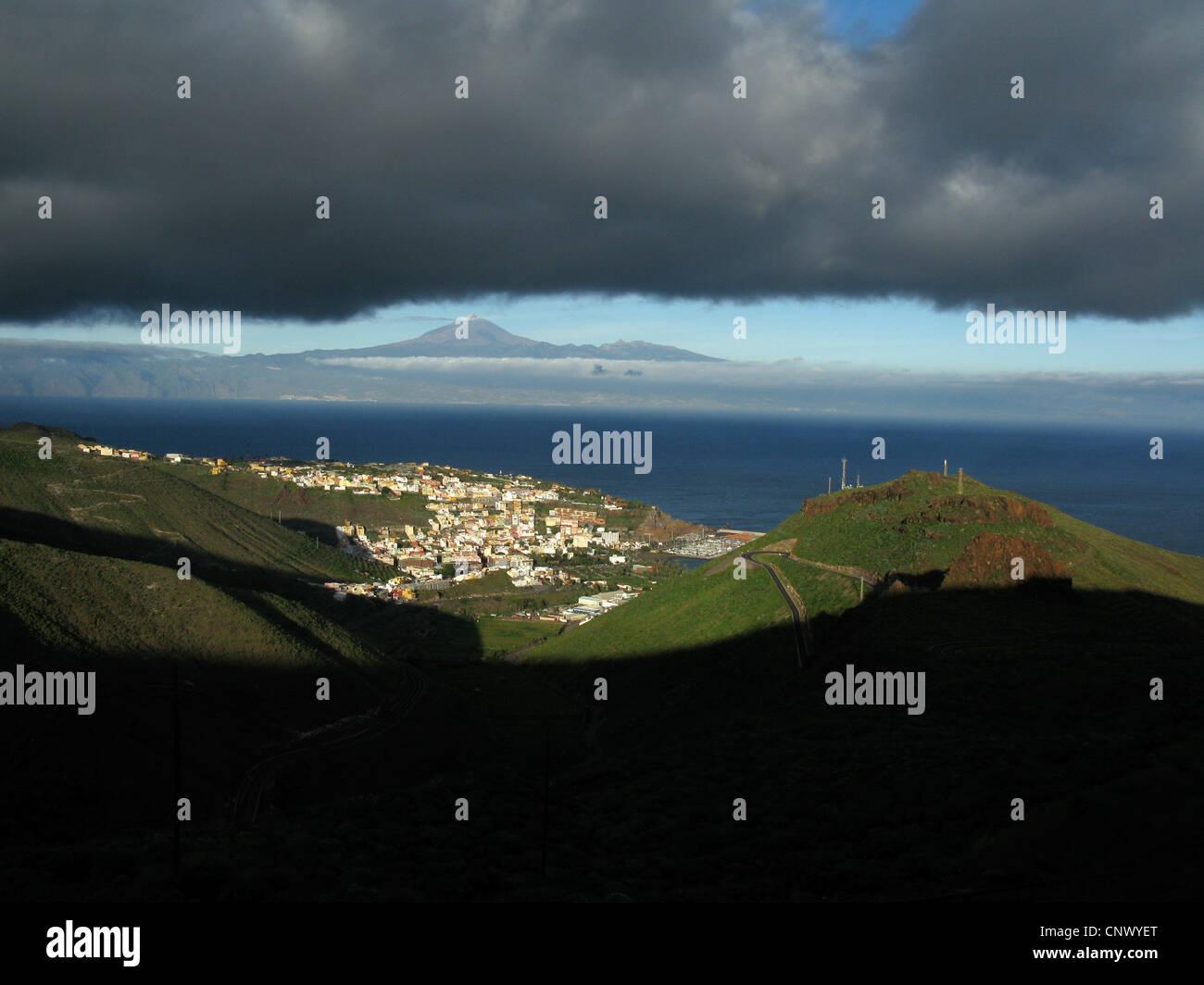 black clouds over San Sebastian, Tenerife with Teide in the background, Canary Islands, Gomera, San Sebastian De - Stock Image