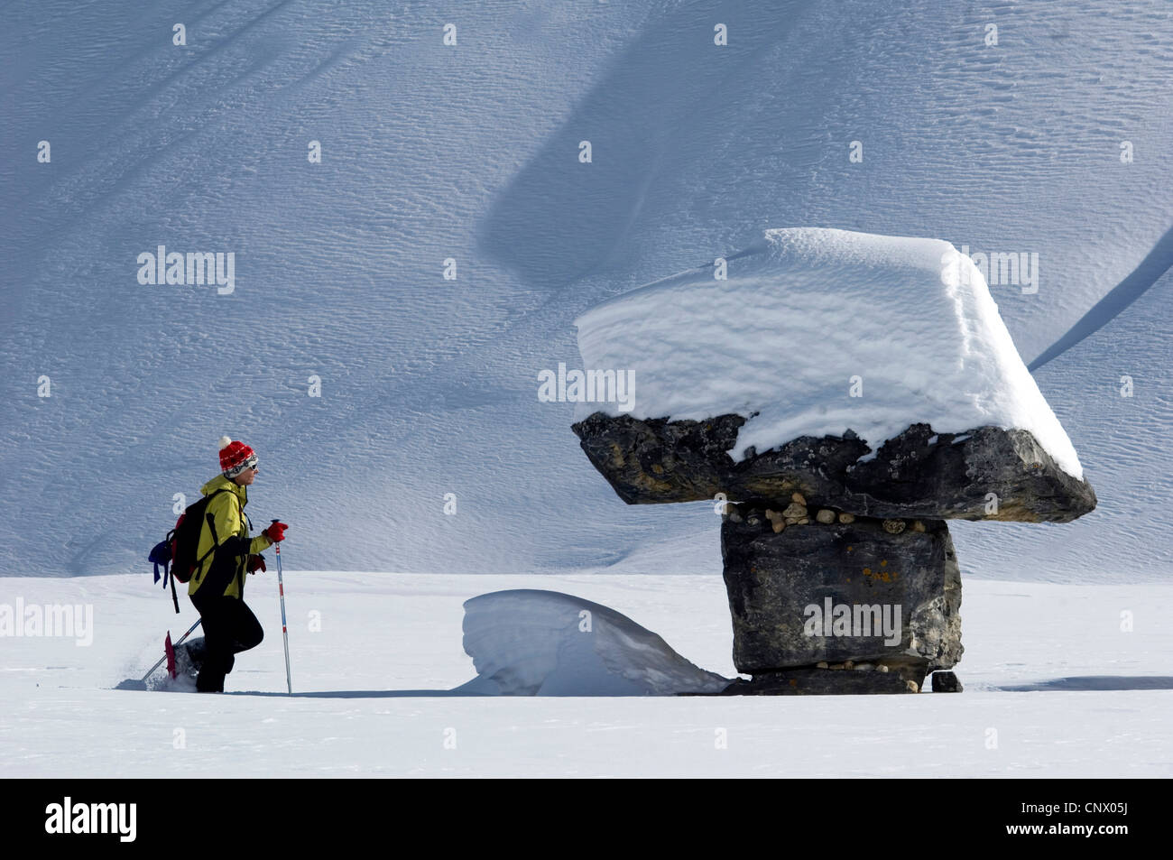 snow shoe hiker in north of Alps mountains, France - Stock Image