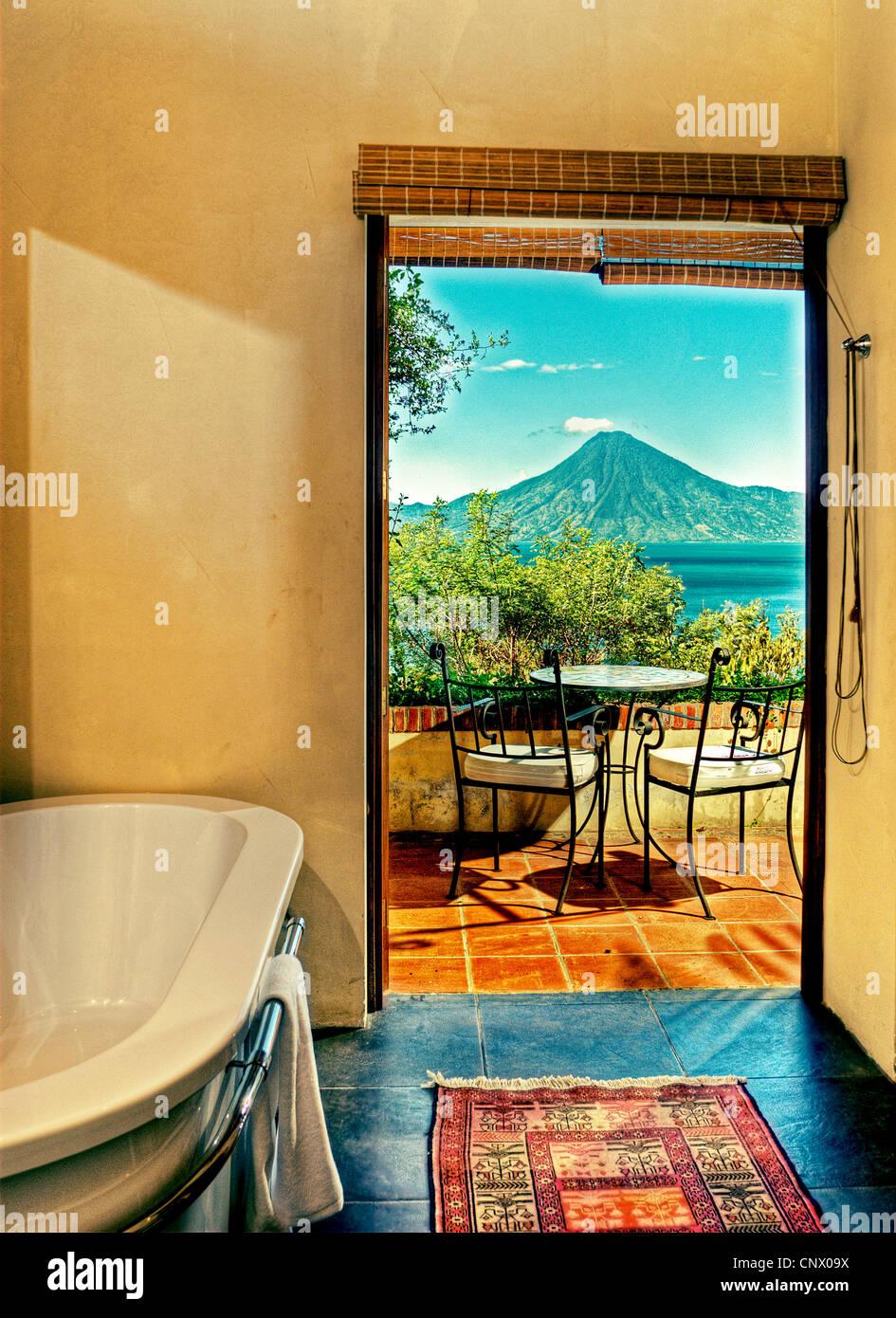 View of Lake Atitlan and San Pedro Volcano from the villa at Casa Palopo Hotel. - Stock Image