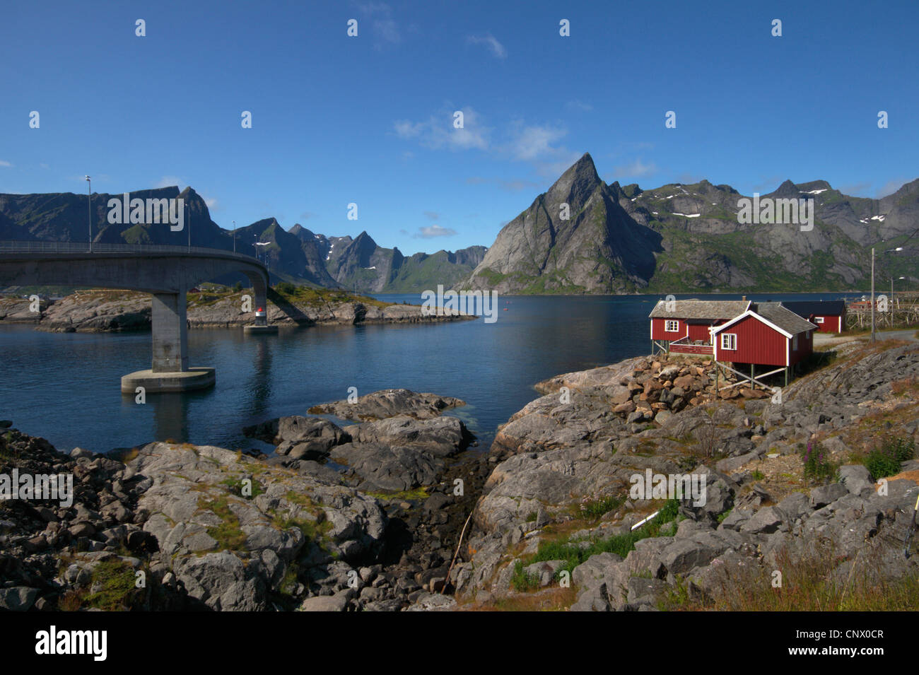 Olstinden mountain in Reine fiord, view from Hamnoy, Norway, Lofoten Islands, Moskenesy Stock Photo