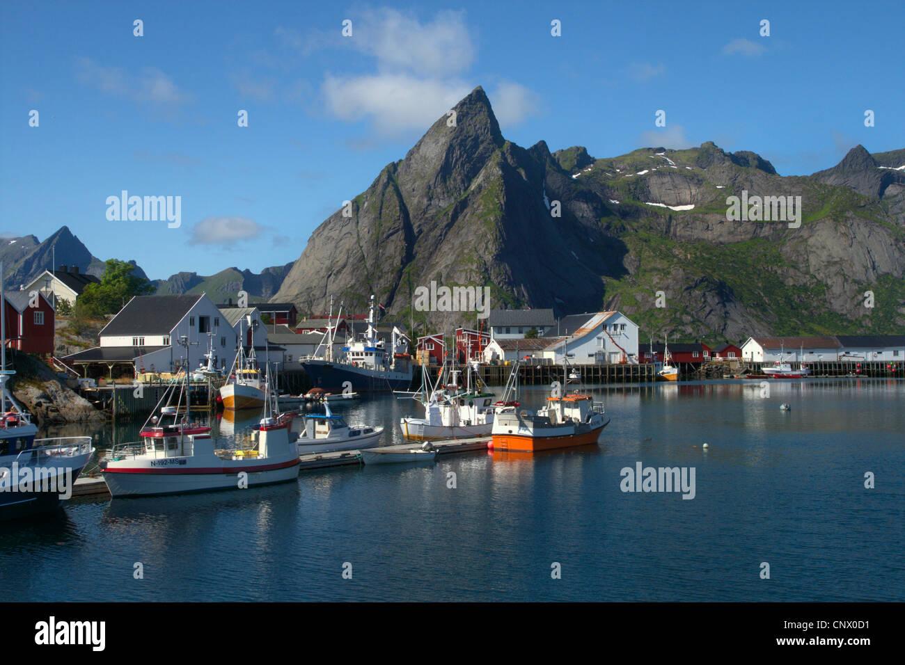fishing village with mountain Olstinden, Norway, Lofoten Islands Stock Photo