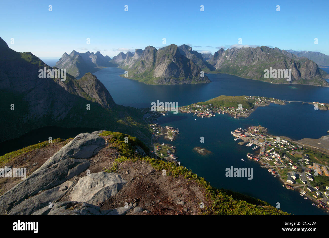 Reinefiord (Kjerkfiorden), view from Reinebringen with Reine and Olstinden, Norway, Lofoten Islands, Moskenesy Stock Photo
