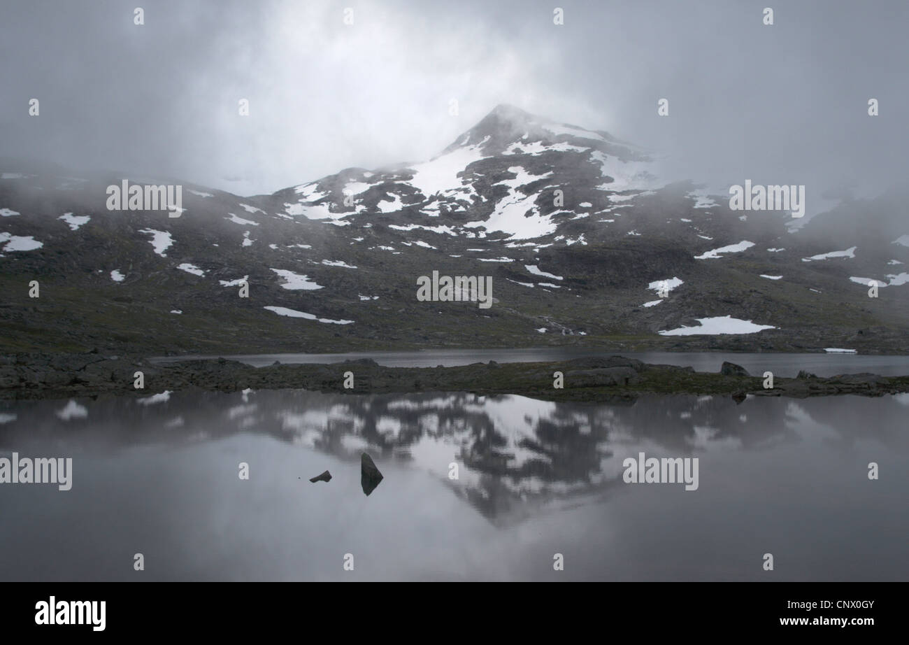 waft of mist over a mountain lake, Norway, Jotunheimen National Park - Stock Image