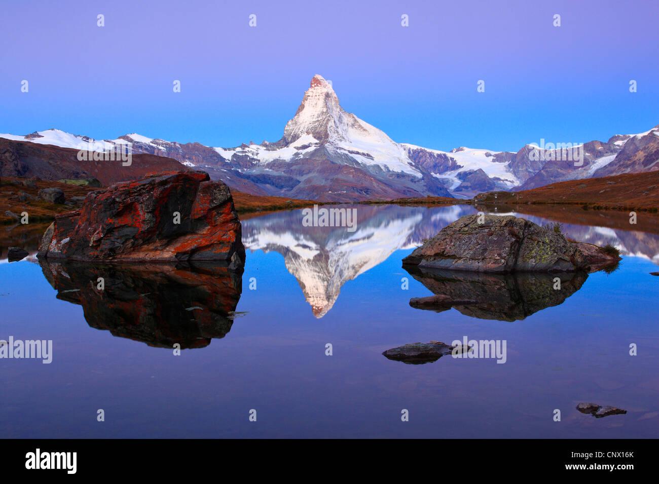 view at the Matterhorn from a mountain lake, Switzerland, Valais Stock Photo