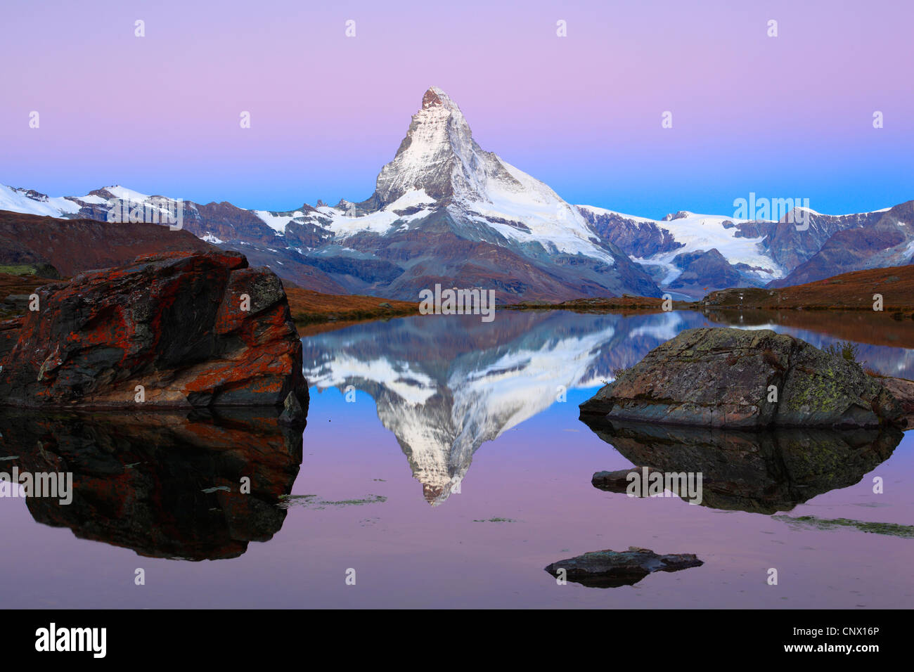 view at the Matterhorn from a mountain lake, Switzerland, Valais Stock Photo