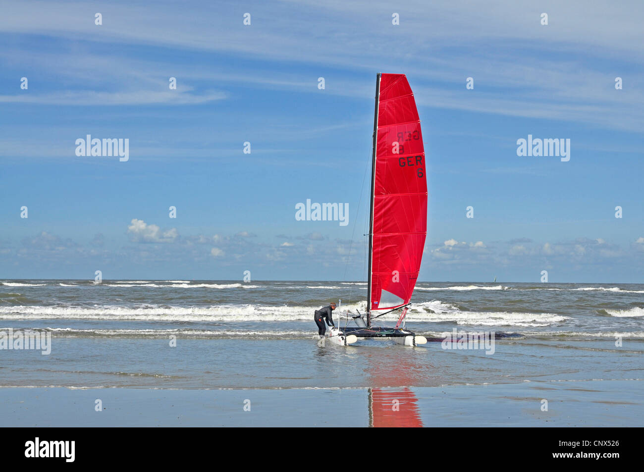 person launching a catamaran, Germany, Lower Saxony, East Frisia Stock Photo