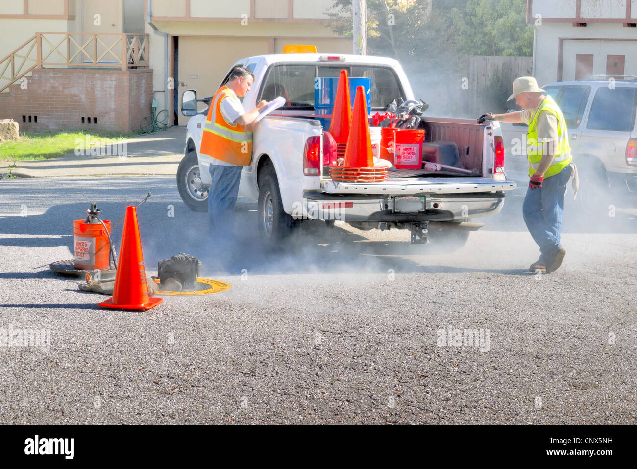 Smoke testing a city sewer system for leaks - Stock Image