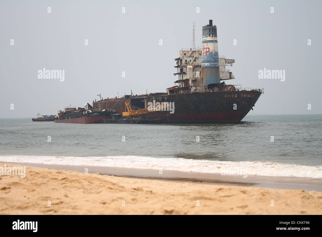 ship being dismantled offshore Candolin Goa India - Stock Image