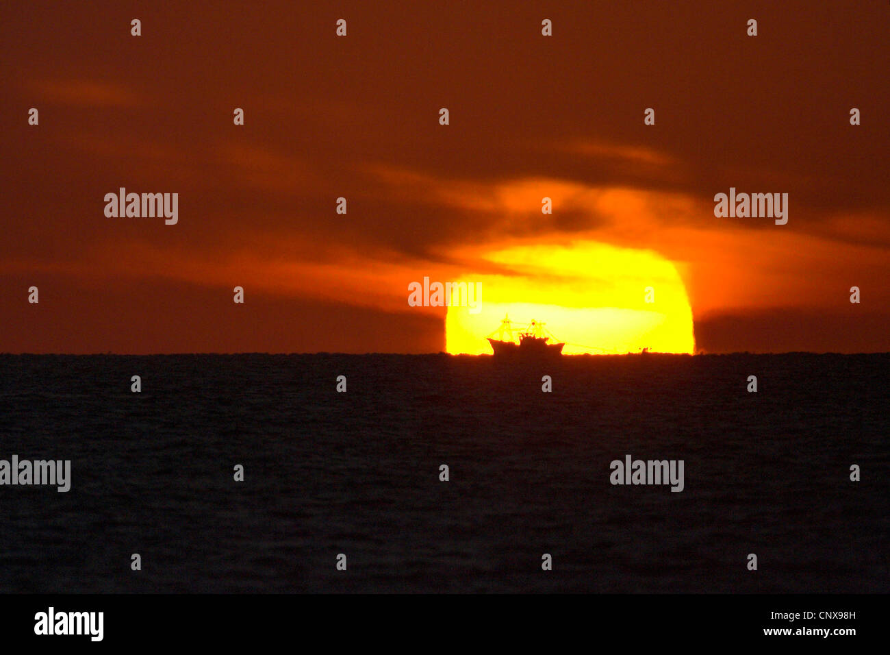 sunset with ship, Spain, Huelva - Stock Image