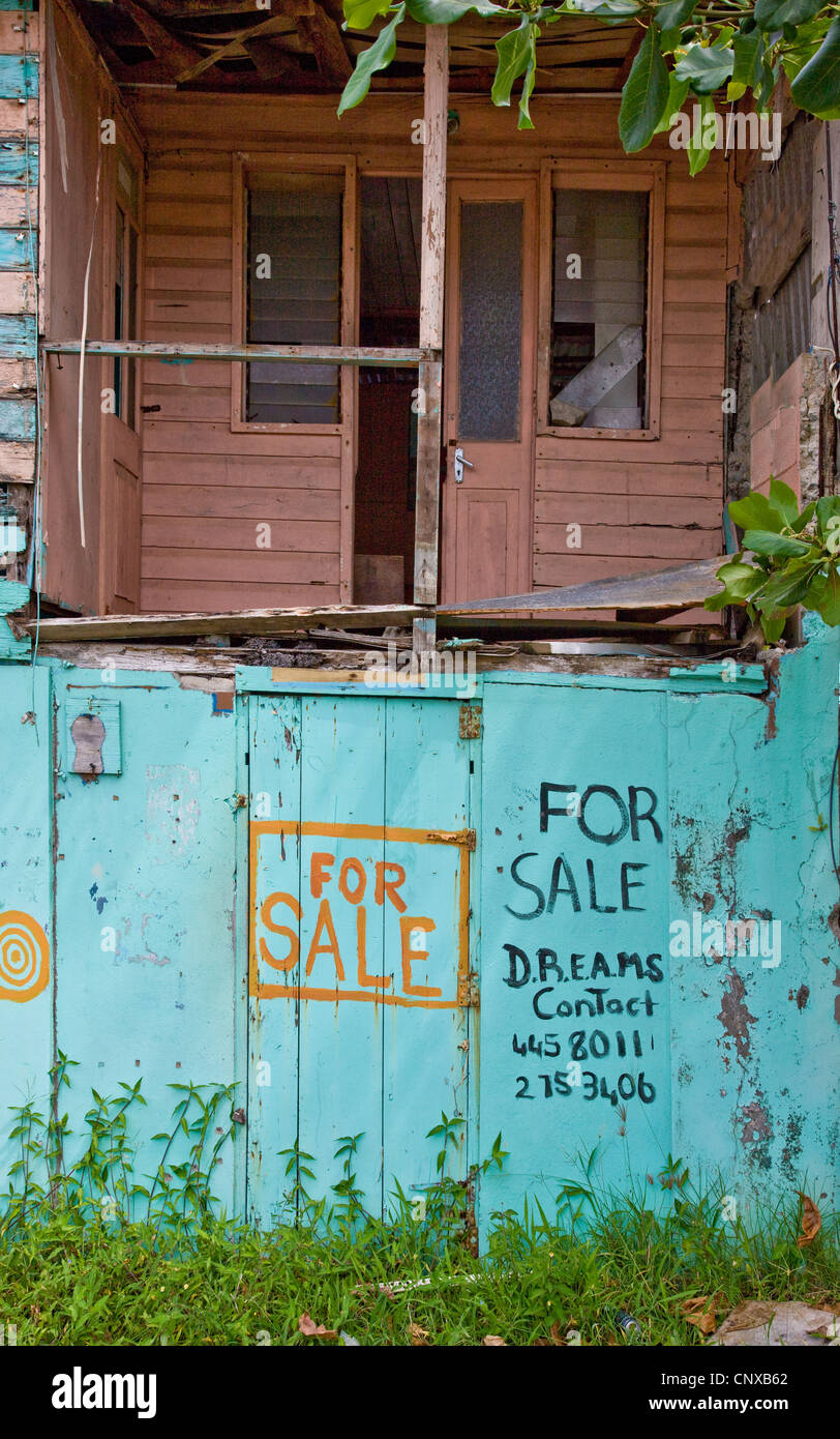 Derelict house for sale in the seaside village of Calibishie on the island of Dominica sold as a renovation project Stock Photo