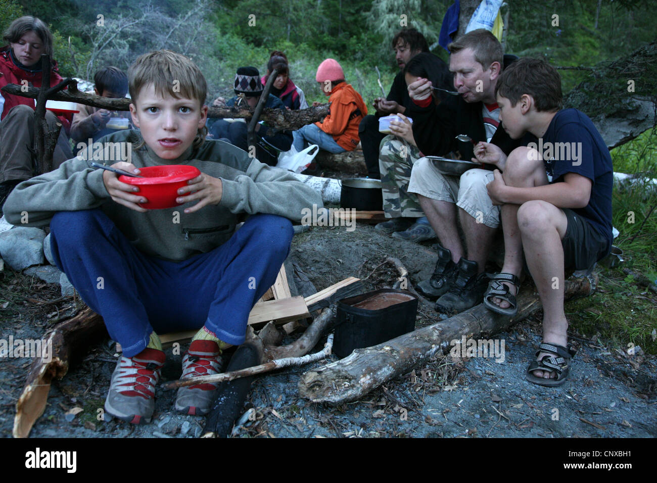 Tourist eating during a trekking in the Altai Mountains, Russia. Stock Photo