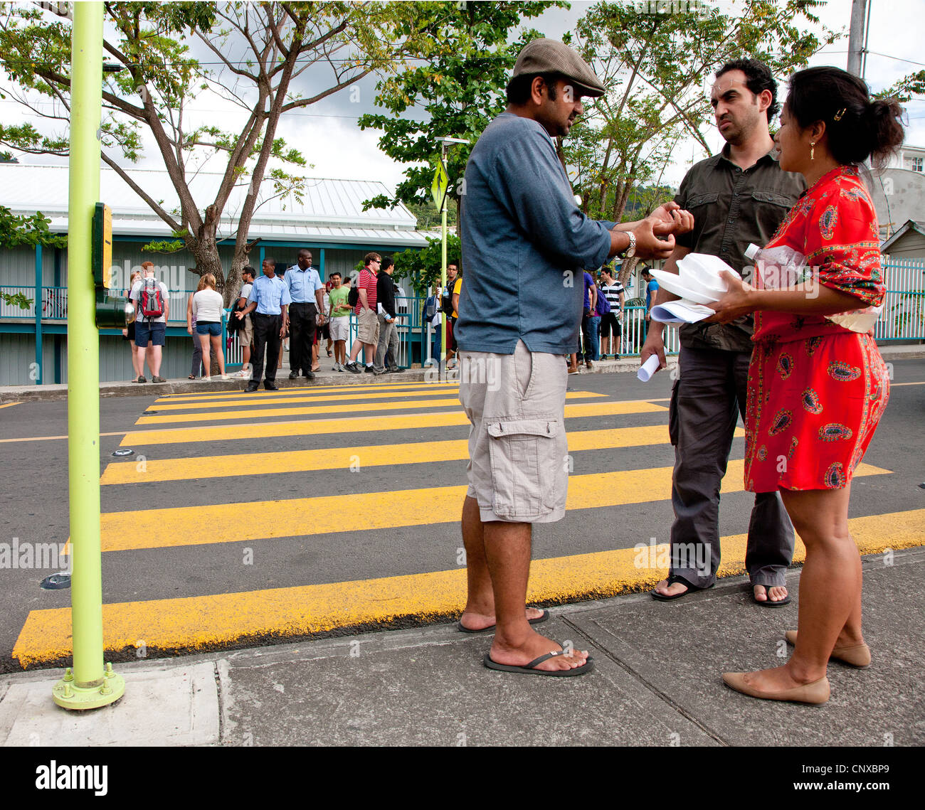 Mature students at Ross University Medical School at Picard Dominica hang out and chat at a patrolled pedestrian - Stock Image