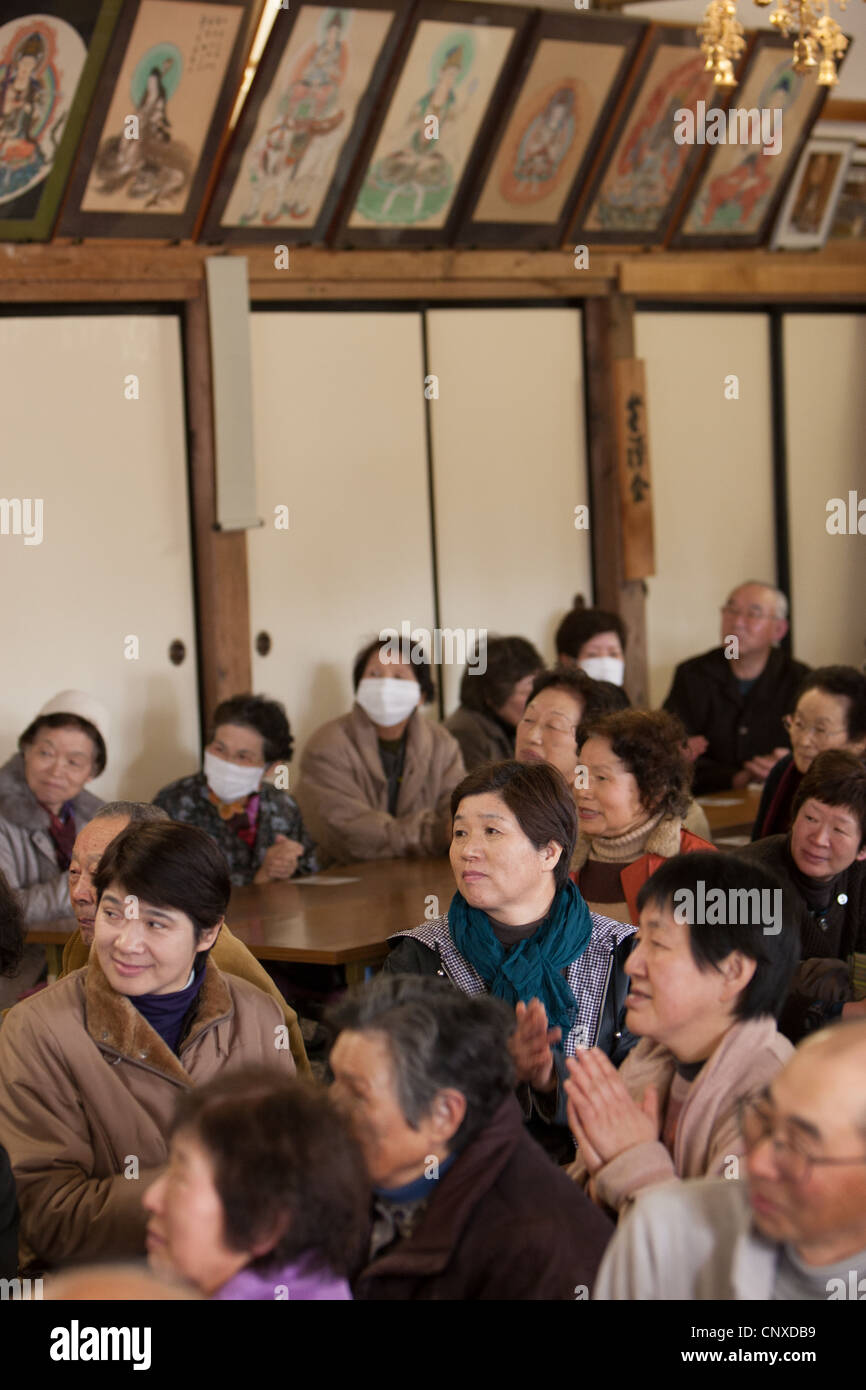 Elderly residents of Minami-Soma town enjoy a show to help them cope with stress, post March2011 tsunami disaster, - Stock Image