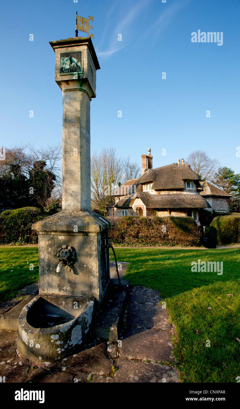 Sundial and Circular Cottage in Blaise Hamlet - a complex of pretty cottages arranged around a communal green in - Stock Image