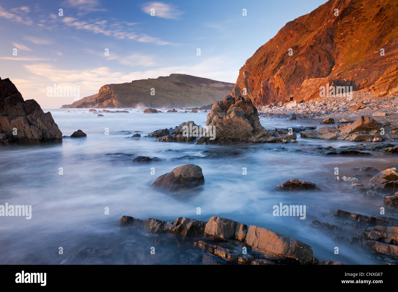 High tide floods the rocky ledges of Duckpool beach on the North Cornish coast, Cornwall, England. Spring (March) - Stock Image