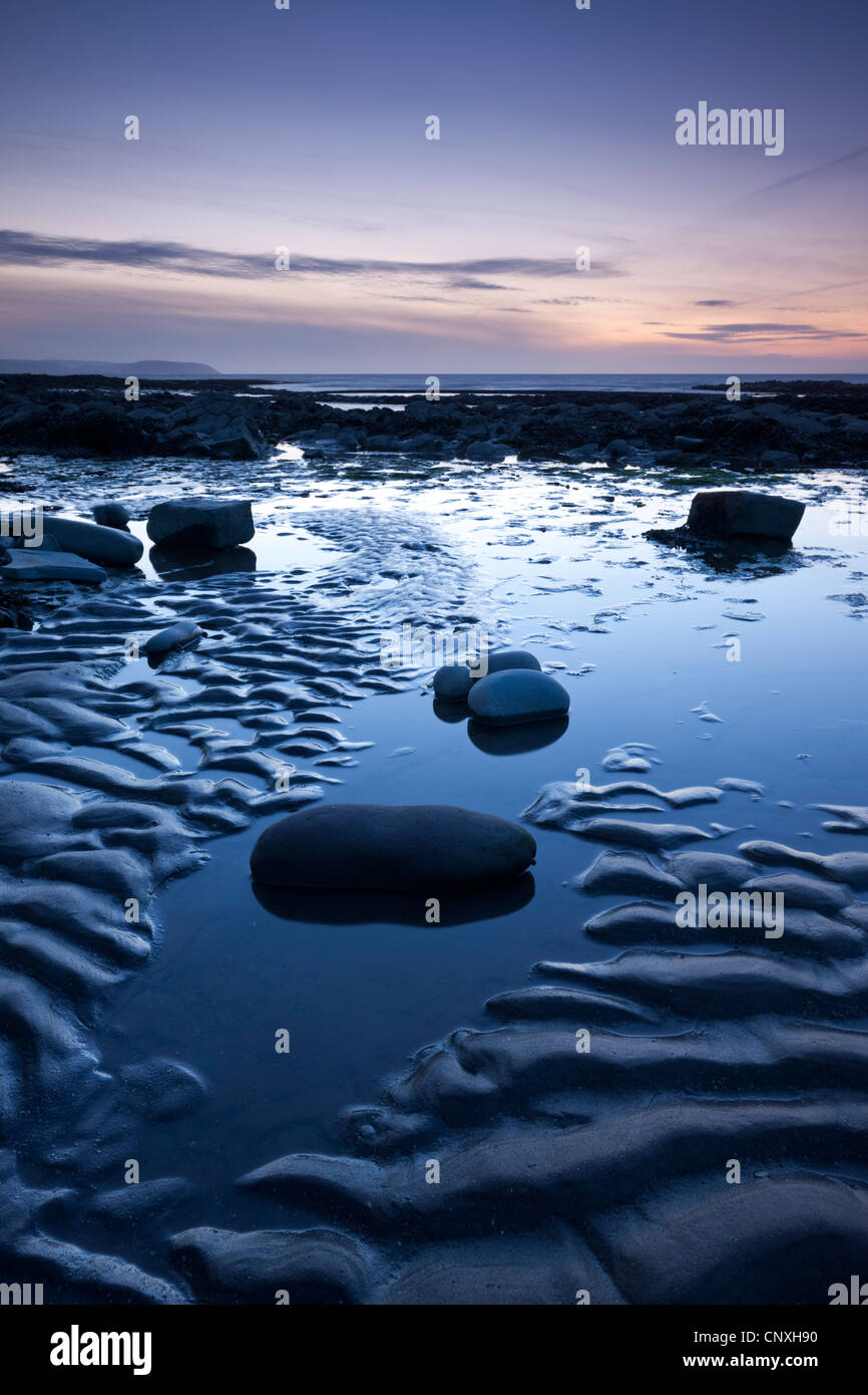 Twilight on the shores of Kilve Beach, Somerset, England. Spring (April) 2011 - Stock Image