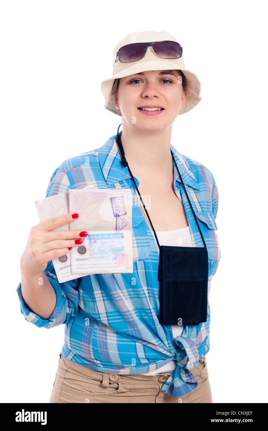 Happy traveller woman showing passport, isolated on white background. - Stock Image