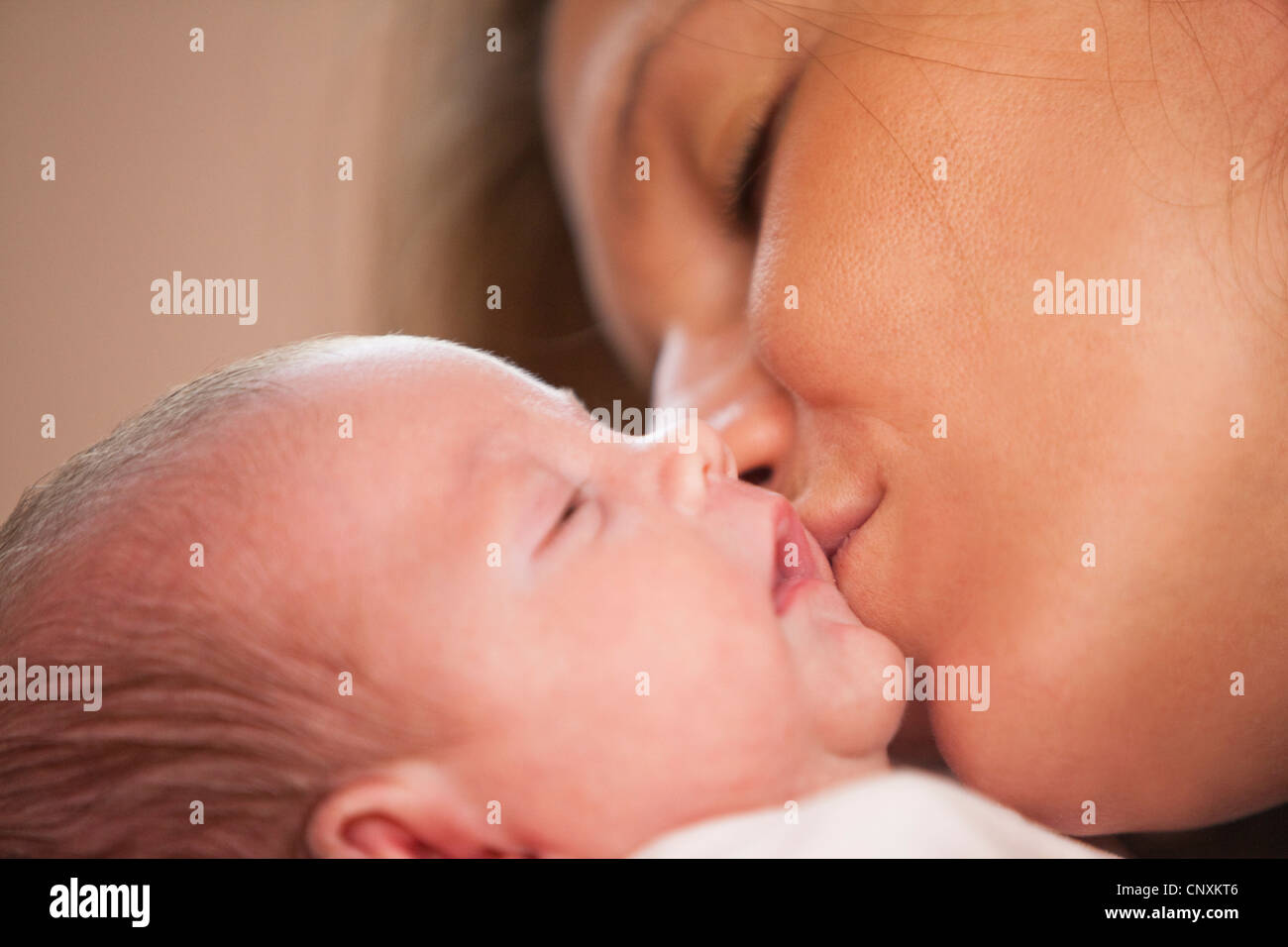 baby girl and mother - Stock Image