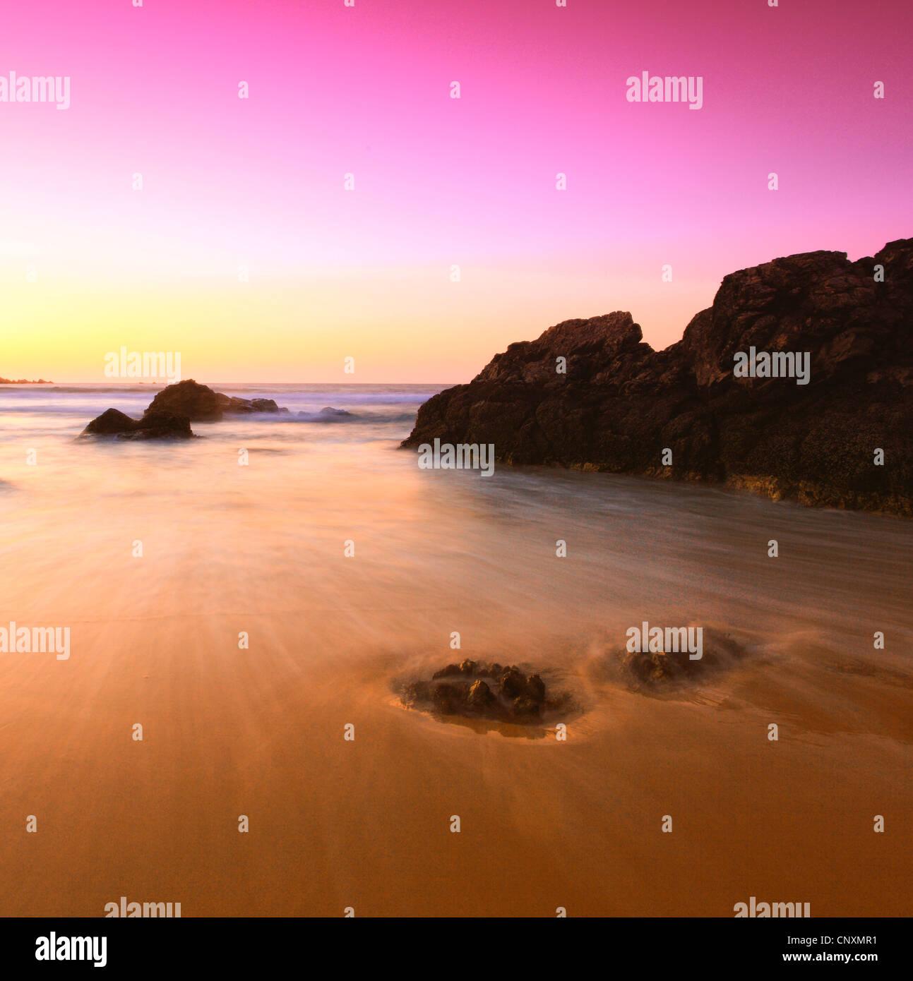 coastal rock at sandy beach in evening light, United Kingdom, Scotland - Stock Image