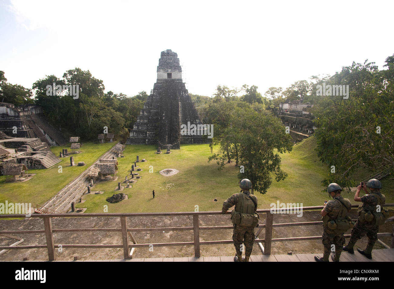 Soldiers guard tourists at Tikal National Park, Guatemala - Stock Image