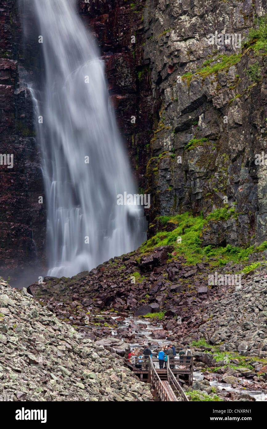 Tourists on viewing platform looking at Njupeskär, the highest waterfall in Sweden, Fulufjället National - Stock Image
