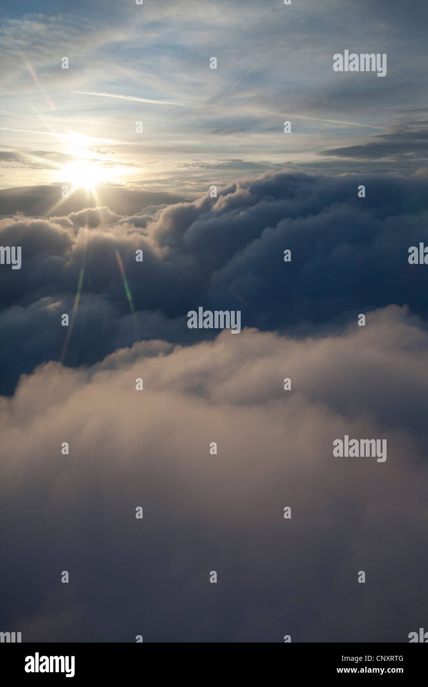 sunburst above the clouds from an aircraft - Stock Image