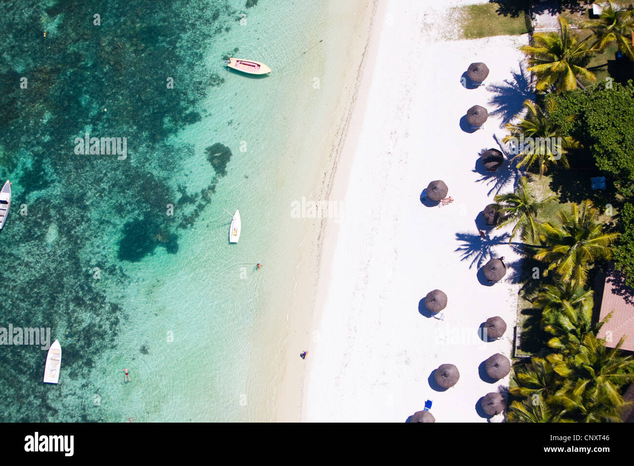 Helicopter view of white sand tropical beach and turquoise ocean - Stock Image