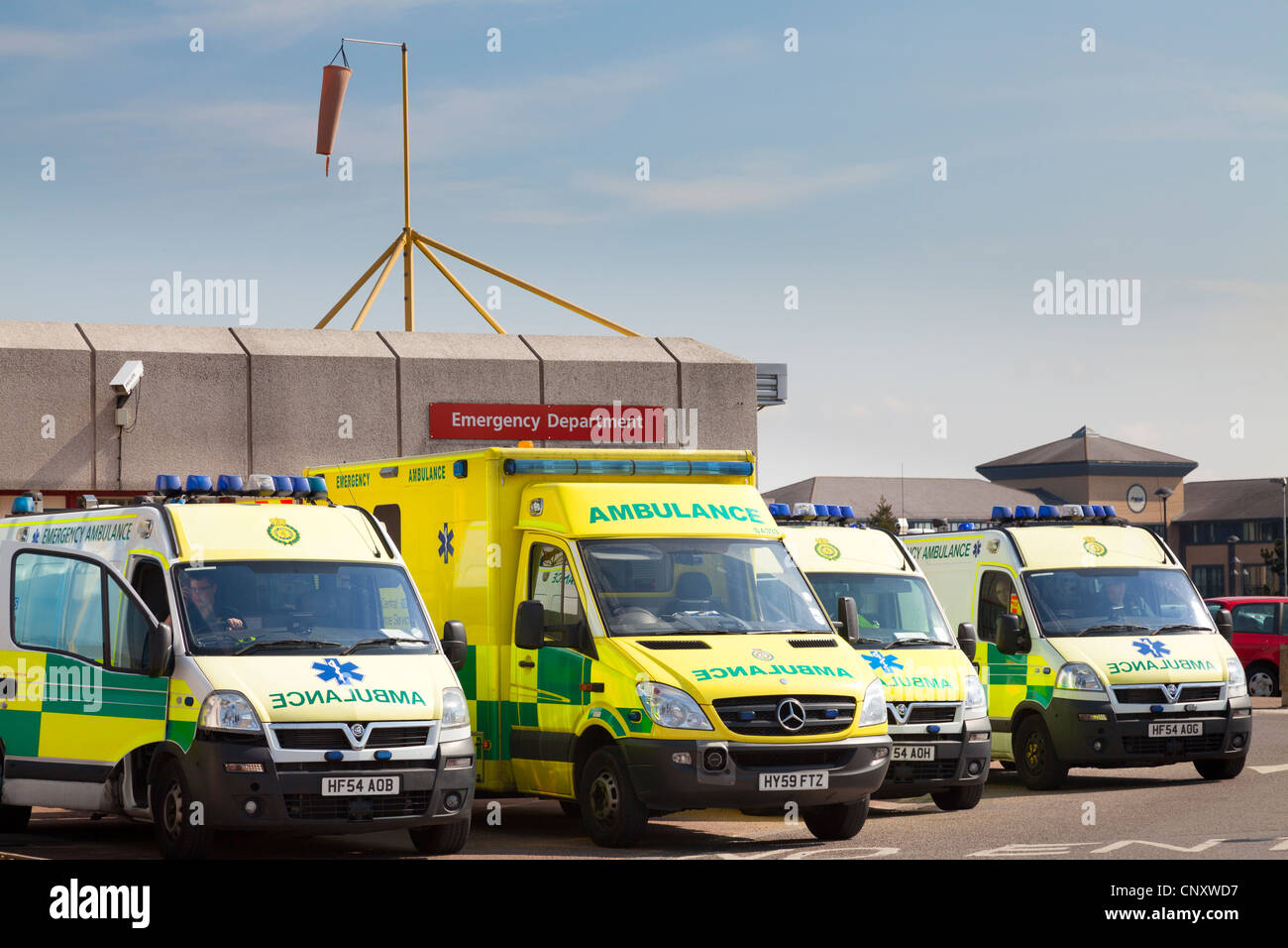 Emergency ambulances parked outside accident and emergency department of Royal Bournemouth Hospital. - Stock Image