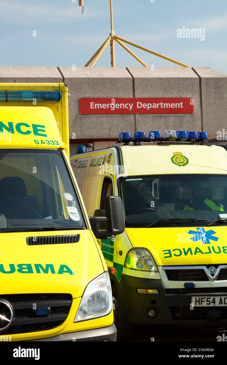 Emergency ambulances parked outside accident and emergency department of Royal Bournemouth Hospital - Stock Image