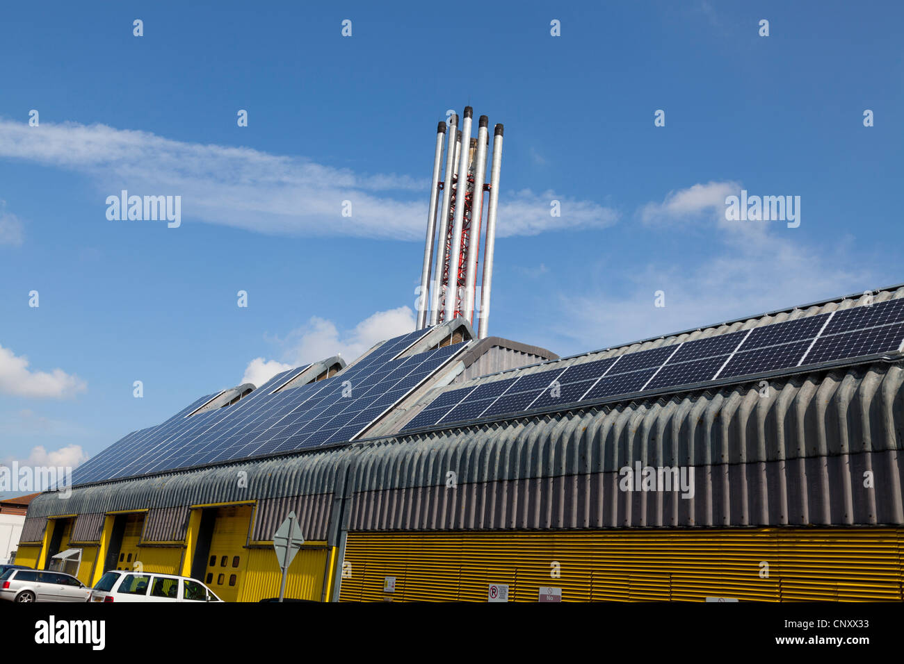 industrial solar panels on hospital plant room - Stock Image