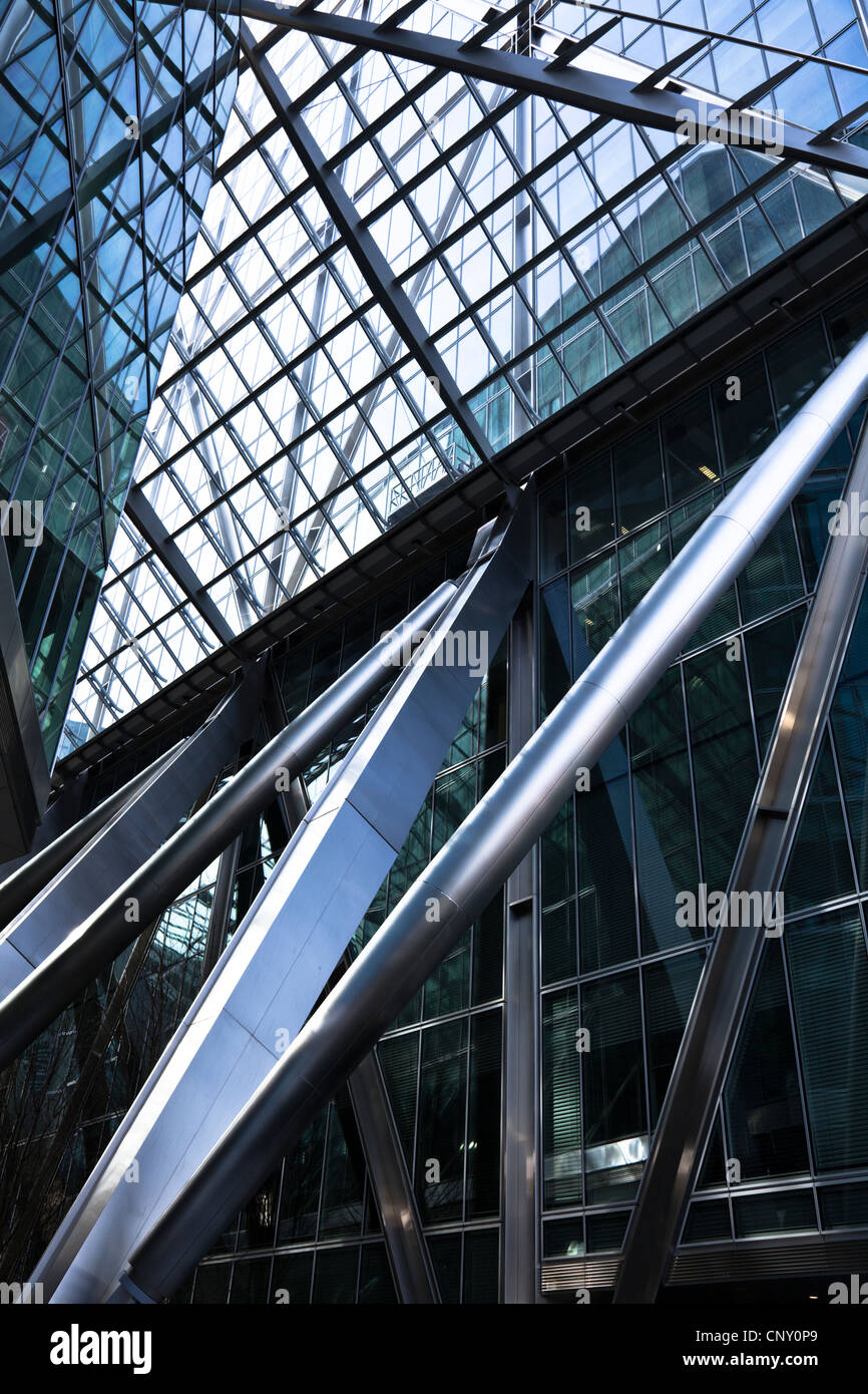 Modern architecture in steel and glass in the Broadgate Tower, City of London creates abstract patterns and reflections - Stock Image