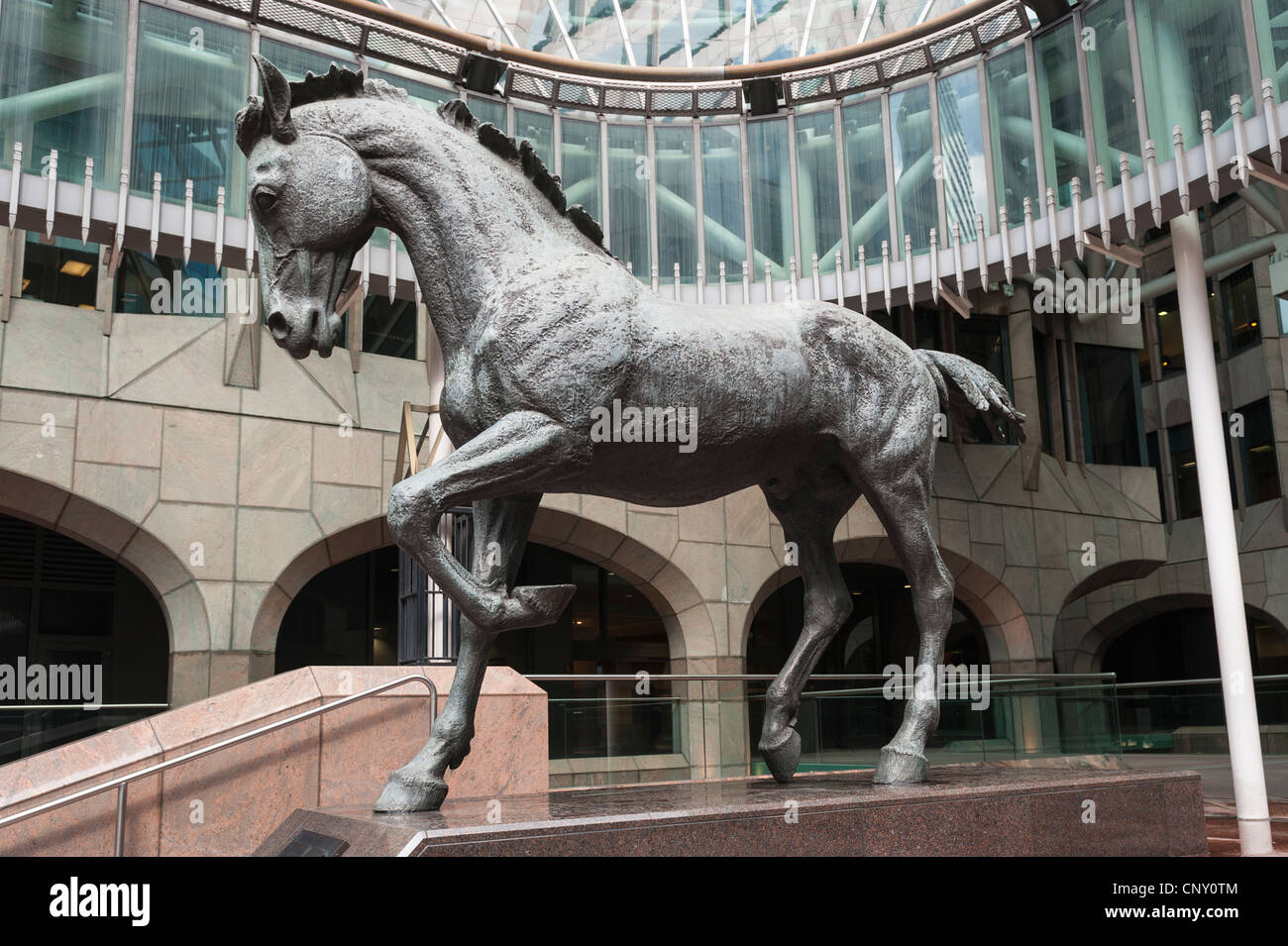 City of London Minster Court statue one of 3 mincing horses by Althea Wynne by this postmodern-gothic office block Stock Photo