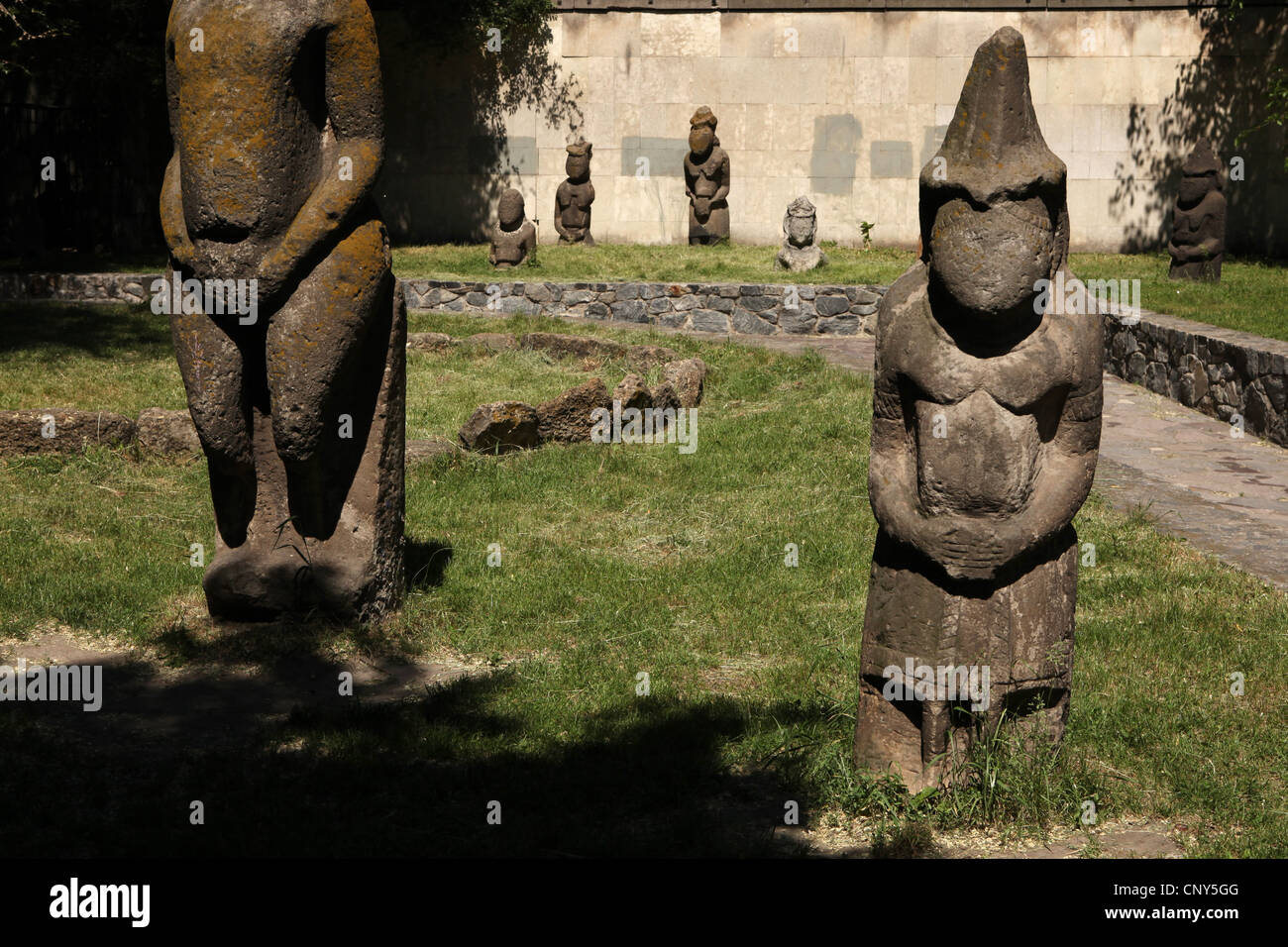 Kipchak stone statues known as the Stony Women exhibited in front of the Historical Museum in Dnipro (Dnipropetrovsk), - Stock Image