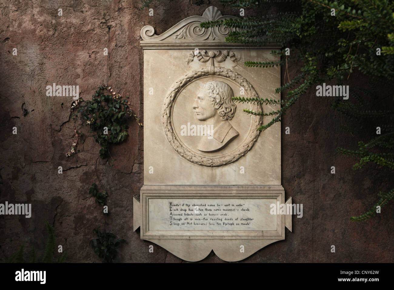 Commemorative plaque to English Romantic poet John Keats beside his grave at the Protestant Cemetery in Rome, Italy. - Stock Image