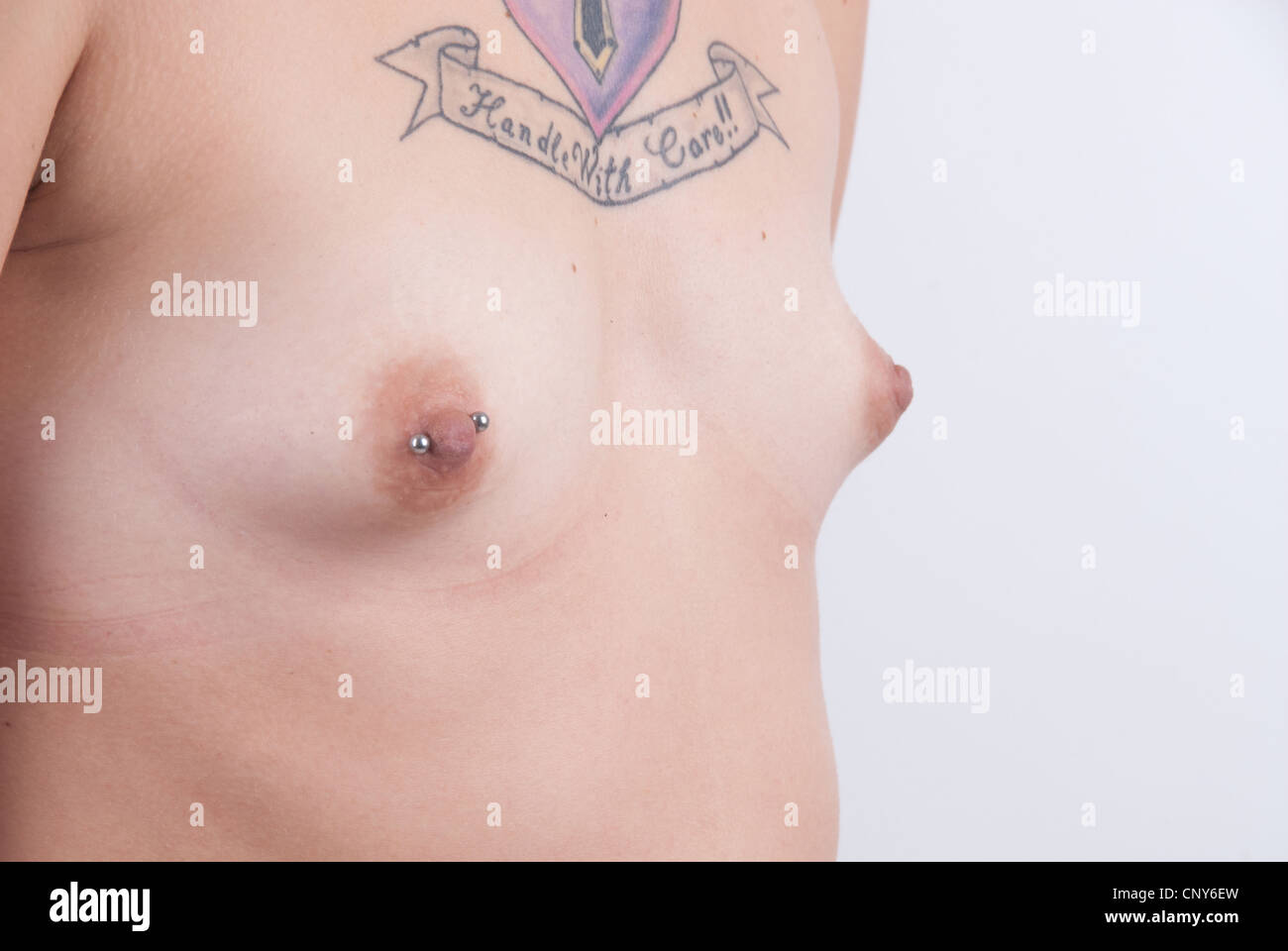 nude caucasian female chest showing small breasts with pierced
