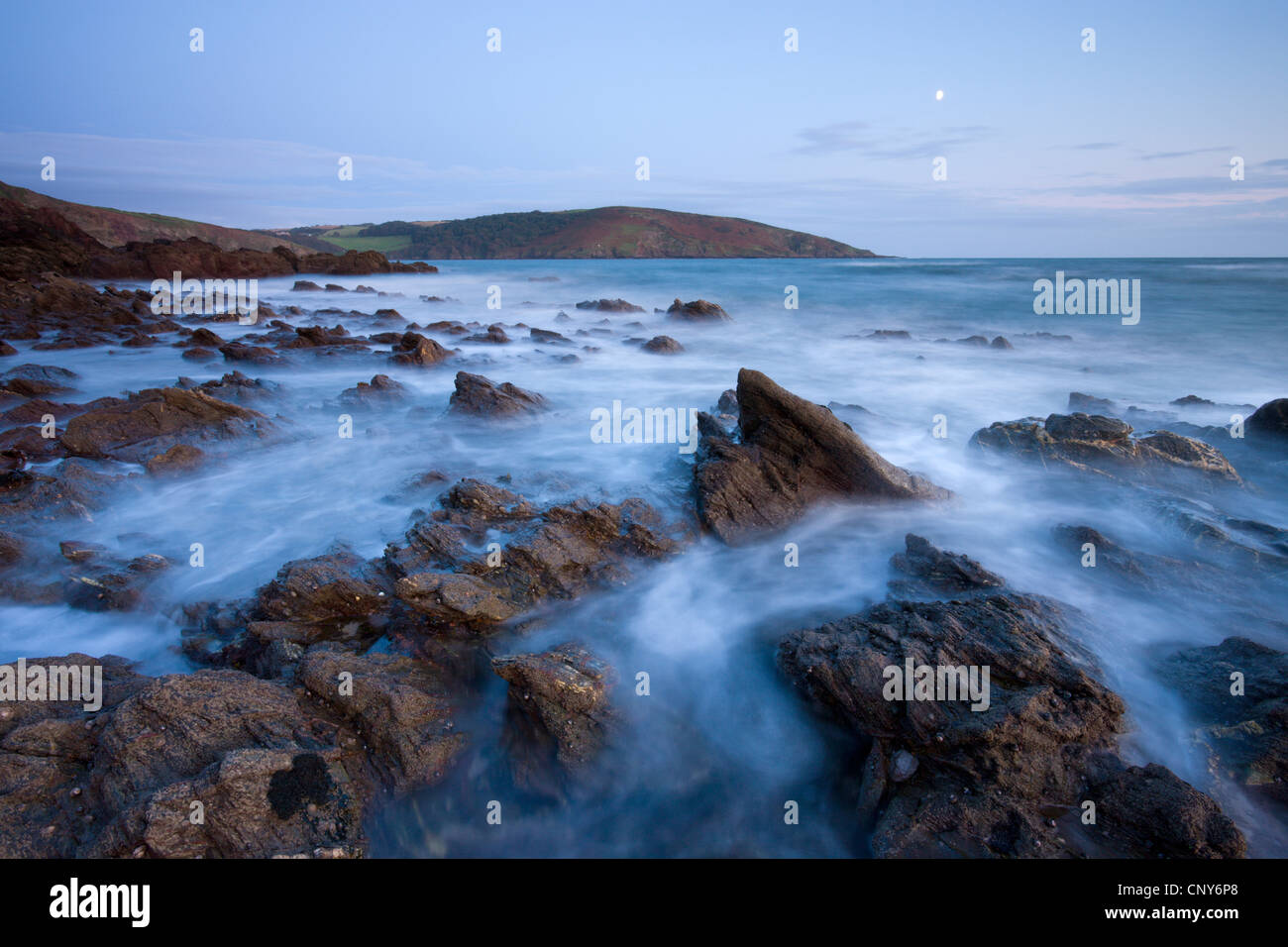 Incoming tide swirls around the rocky shores of Wembury Bay in South Devon, England - Stock Image