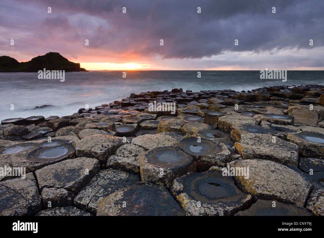 Sunset over the Giants Causeway, County Antrim, Northern Ireland - Stock Image
