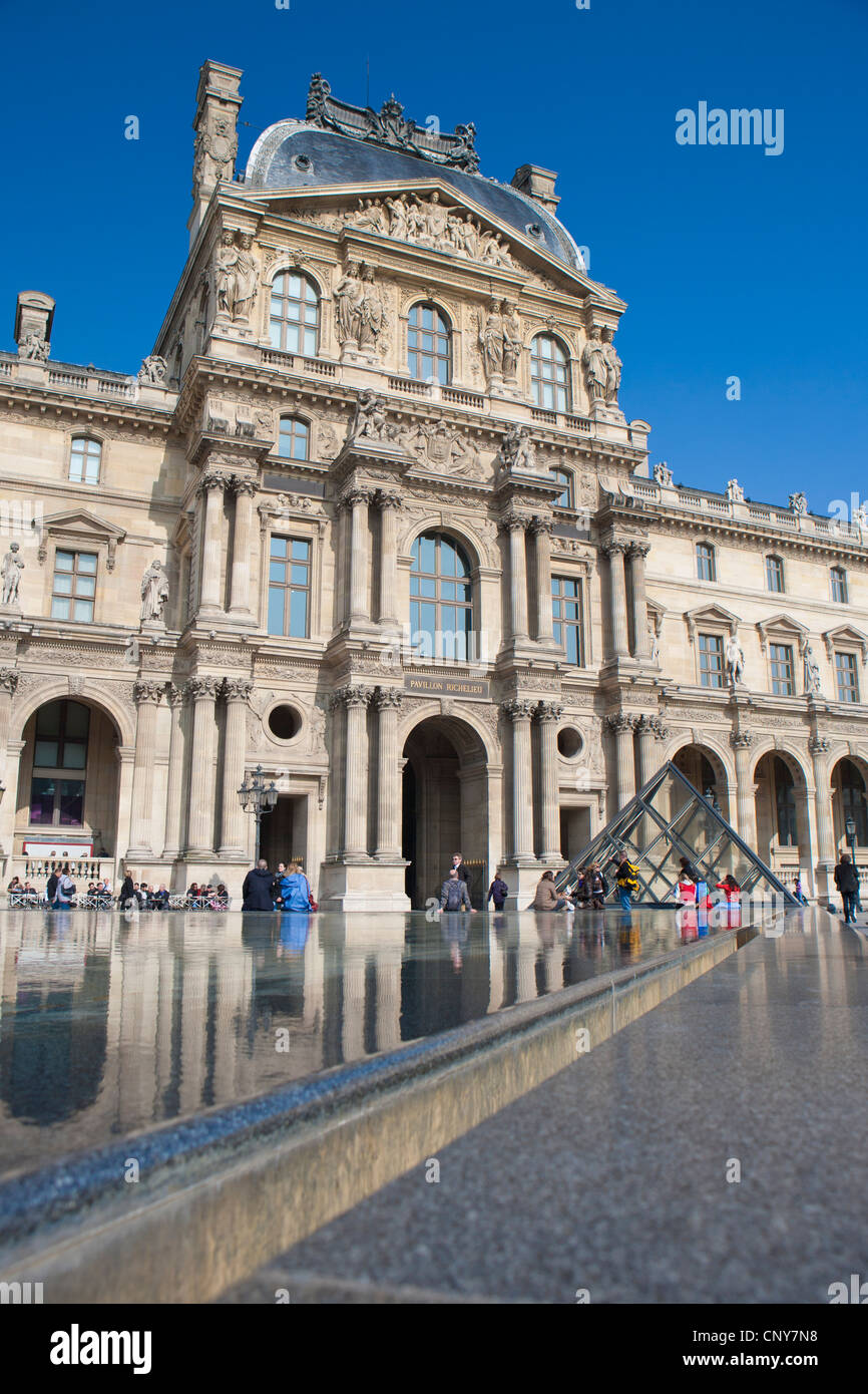 Reflective Pool in front of the Pavillon Richelieu, Louvre Square - Stock Image