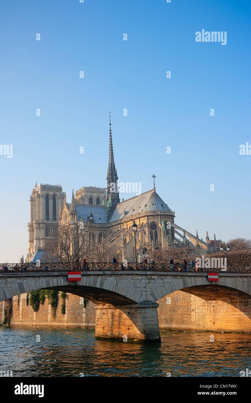 Notre Dame de Paris and The Archbishop's Bridge over the Seine - Stock Image