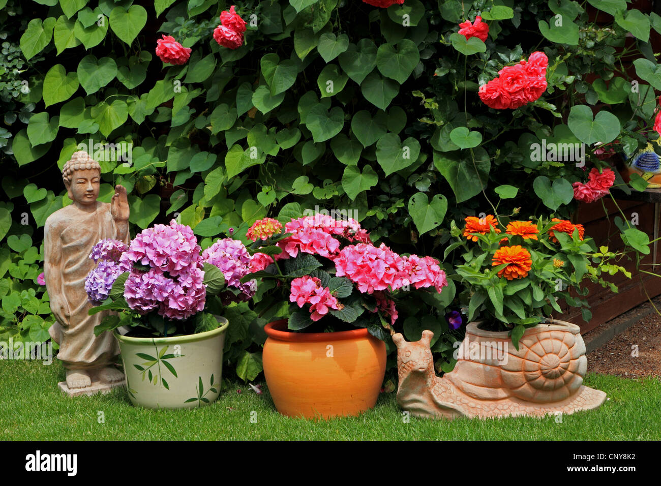 Summer House With Flowers And Garden Figures, Germany   Stock Image