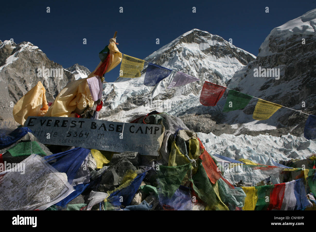 Buddhist prayer flags in the Everest Base Camp (5,364 m) in Khumbu region in the Himalayas, Nepal. - Stock Image