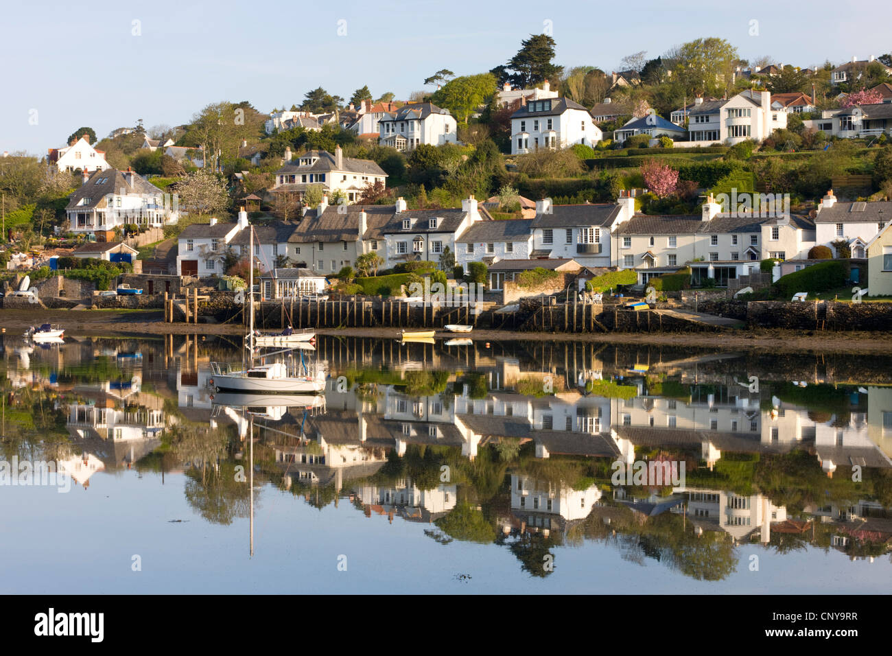 Picturesque South Hams village of Newton Ferrers, viewed from across the River Yealm at Noss Mayo, Devon - Stock Image