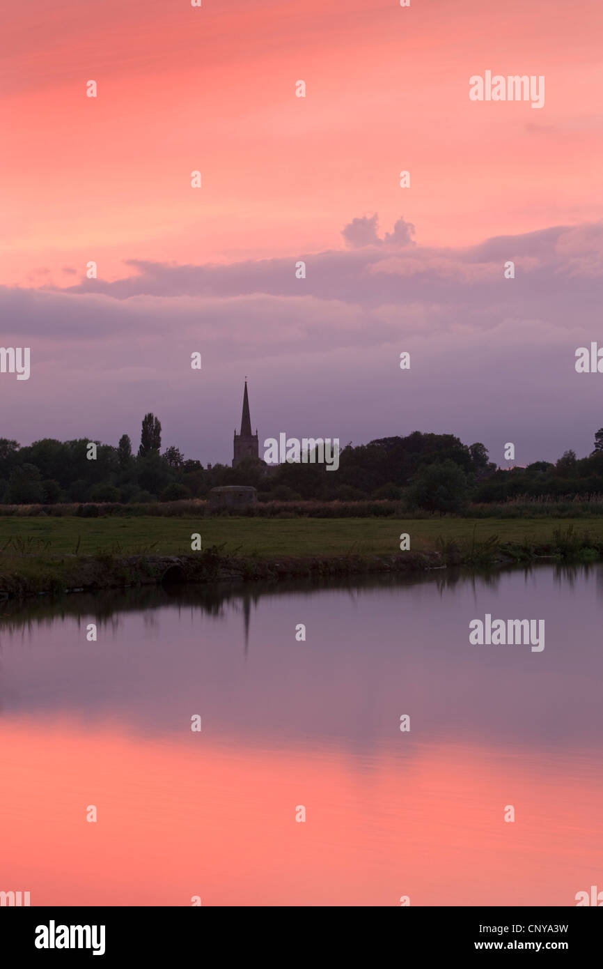 Beautiful sunset over the River Thames and the Church Spire of Lechlade, Cotswolds, Oxfordshire, England. Summer - Stock Image